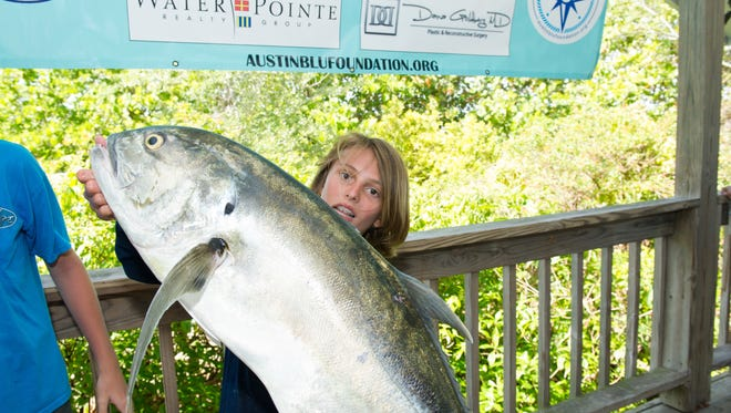 Hunter Hansen holds his trophy fish recently at the inaugural AustinBlu Foundation Land and Sea Fishing Tournament.