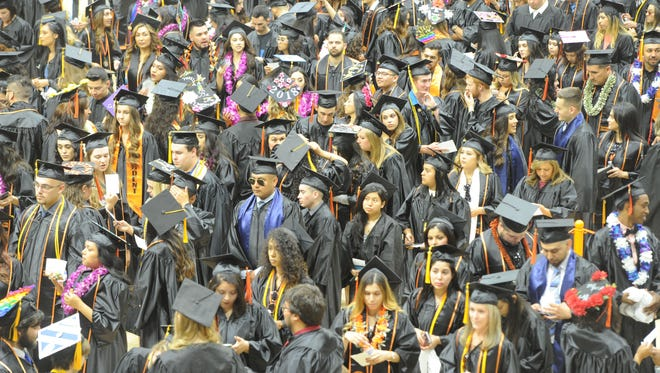 Ventura College graduates gather at the gym before the graduation ceremony on May 18, 2018.