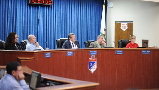 Board members of the Imperial Irrigation District listen to a presentation by U.S. Bureau of Reclamation commissioner Brenda Burman during a board meeting on May 22, 2018.
