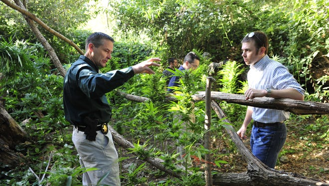 Then-Capt. Mike Boudreaux talks to Stuart Anderson, a former representative for Assemblywoman Connie Conway, during a marijuana eradication operation on public lands.
