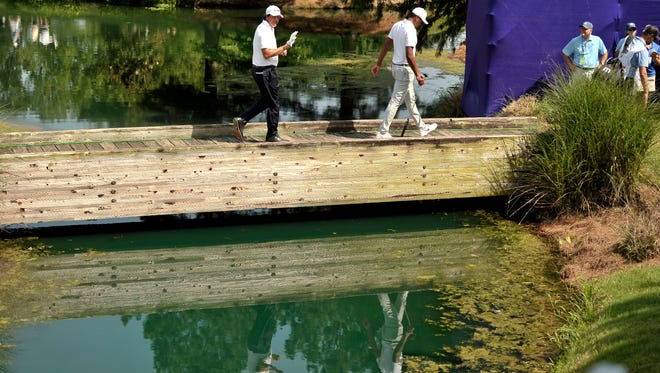 June 8, 2018 - Phil Mickelson, left, waves to fans as he crosses a bridge to the next hole during the second round of the FedEx St. Jude Classic at TPC Southwind.