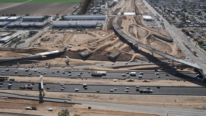 The new I-10/Loop 202 interchange near 59th Avenue in the West Valley is under construction. The new freeway will connect West Phoenix to the Southeast Valley and is expected to open in 2019.
