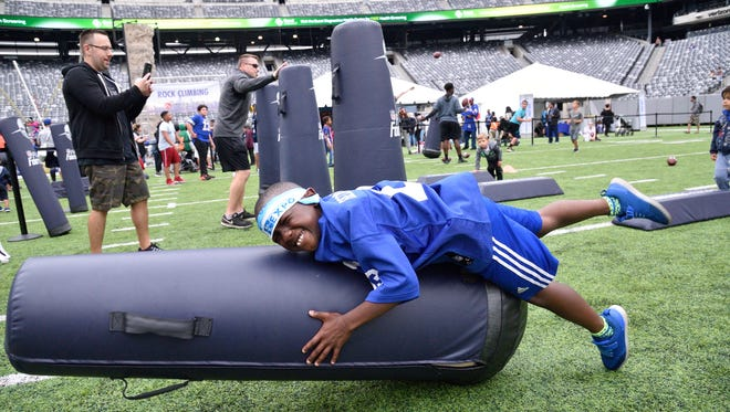 Jaden Francis,9, of Plainfield lands on a tackling dummy at the NBC 4 New York and Telemundo 47 Health & Fitness Expo at Metlife Stadium in East Rutherford on Saturday, June 23, 2018.