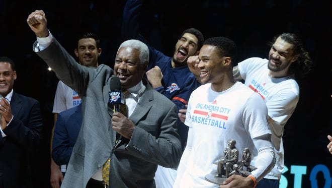 Oscar Robertson leads an MVP chant after a presentation to Oklahoma City Thunder guard Russell Westbrook (0) prior to a game against the Denver Nuggets at Chesapeake Energy Arena.