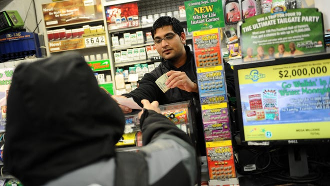 Bautista Ojeda, of Paterson, buys a Mega Millions ticket at Welsh Farms in Clifton in 2013.