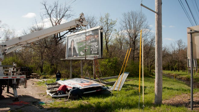 A billboard near Dodd Creek that was blown down in an April storm should not have been repaired and reinstalled, Mountain Home city officials argue. The city's billboard ordinance does not permit new signs and requires that any billboard suffering more than 50 percent damage be removed.