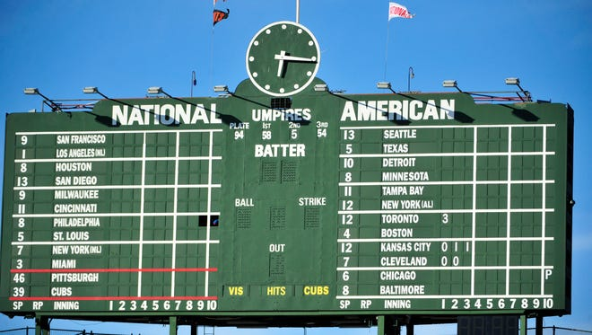 A fan was struck by a metal pin that fell from the manually operated scoreboard in centerfield during the Cubs' game Tuesday.