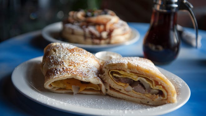 -  The country breakfast wrap with Nutella pancakes in the background from The Brownstone Pancake Factory in Edgewater  AMY NEWMAN/STAFF PHOTOGRAPHER