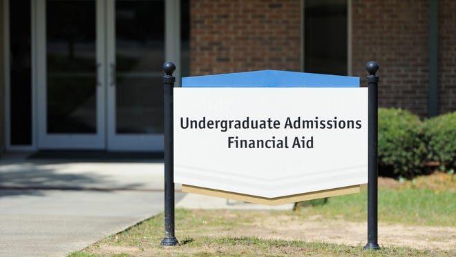 Undergraduate admissions and financial aid sign on public university campus