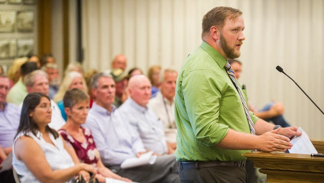Cedar City residents rally behind a proposal to change regulations regarding short-term rentals at a city planning meeting Aug. 7, 2018. Proponents of stricter regulations gathered again Aug. 15 to confront the City Council.
