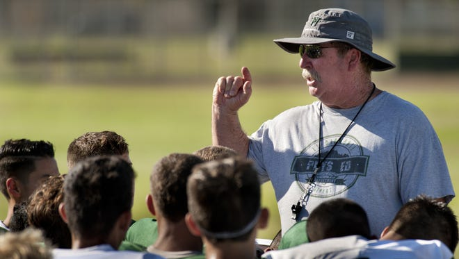 El Diamante football coach Mark Rogers talks with the team after practice on Friday, August 14, 2015.