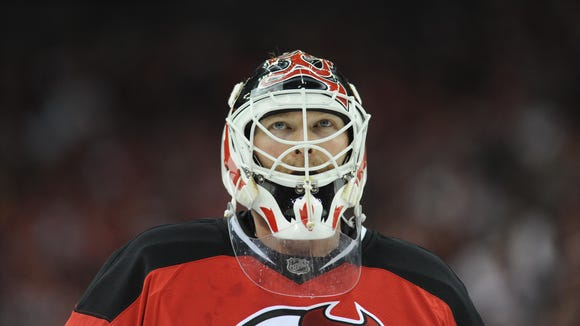 In this April 14, 2010 file photo,  Devils goalie Martin Brodeur looks up to the crowd during Wednesday's 2-1 loss in Game 1 of the first round of the Eastern Conference playoffs against the Philadelphia Flyers.