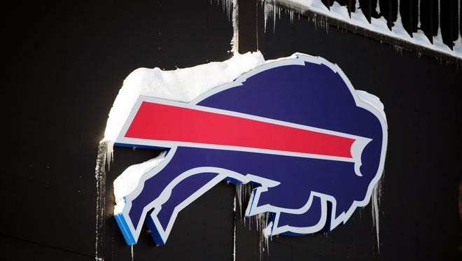 The Buffalo Bills symbol is covered in snow at Ralph Wilson Stadium in Orchard Park, N.Y., on Friday, Nov. 21, 2014.