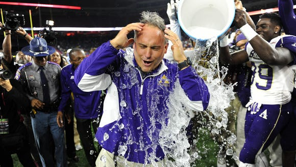 Alcorn State head coach Jay Hopson is drenched with