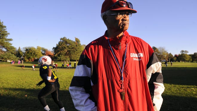 Willard Walker, 80, area civil rights leader, public servant and Kappa Express football program founding member and head coach, watches  Kappa Express football  practice at St. Joseph Park in Lansing Thursday  10/9/2014  .     (Lansing State Journal | Rod Sanford)