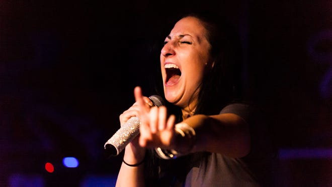 Amanda Legault, lead vocalist of Darling Down, preforming at The Warehouse Friday night.
