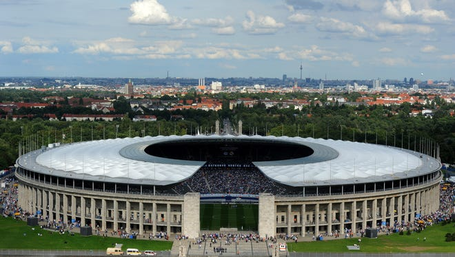 General exterior view of Berlin's Olympic stadium (Olympiastadion) taken as supporters arrive to attend the friendly match Hertha Berlin vs Real Madrid on July 27, 2011.