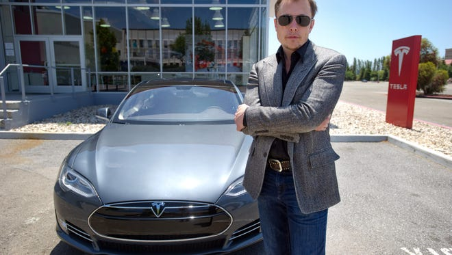 Elon Musk CEO of Tesla with a Model S electric car outside the Tesla factory in Fremont, Calif.