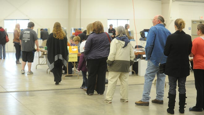 A steady stream of people made there way through lines in the Expo Center Tuesday afternoon November 4, to cast their votes.