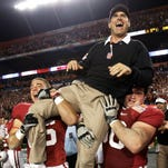 Stanford football coach Jim Harbaugh is lifted by players after a 40-12 victory over Virginia Tech in the Orange Bowl on Jan. 3, 2011, in Miami.