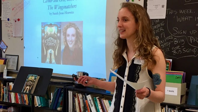 Sarah Jean Horwitz, a Class of 2009 alum, discusses her first novel at Jefferson Township Middle Schoo