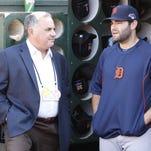 Detroit Tigers assistant general manager Al Avila, left, talks with his son Alex Avila on Oct. 10, 2013.