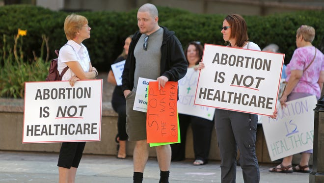 Anti-abortion and abortion rights groups protested in front of the Hamilton County Courthouse in this 2014 file photo.