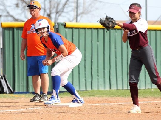 San Angelo Central High School head softball coach David Millsap looks for a chance to send Sydnie Gilbert from third base to home during a recent game in 2018. Millsap has guided the Lady Cats to a second straight playoff appearance. It's his first season as head coach.