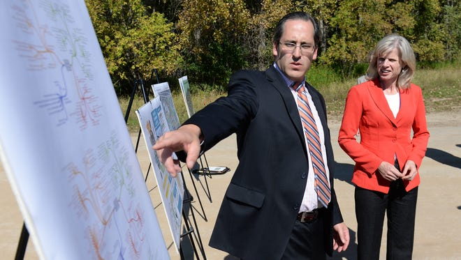 Gubernatorial candidate Mary Burke listens as Brown County supervisor Troy Streckenbach presents information on a proposed research park from at the site of the former mental health center Thursday.