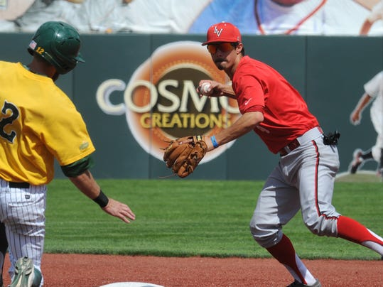 UNLV shortstop Matt McCallister throws to first for a double play after putting out North Dakota State's Andy Wicklund during an NCAA college baseball tournament regional game in Corvallis, Ore., Saturday, May 31, 2014. (AP Photo/Mark Ylen)