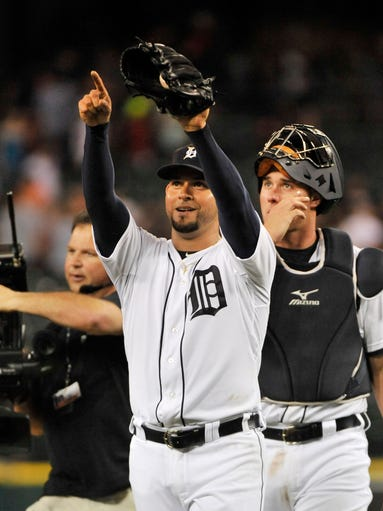 Tigers pitcher Anibal Sanchez points upward after his