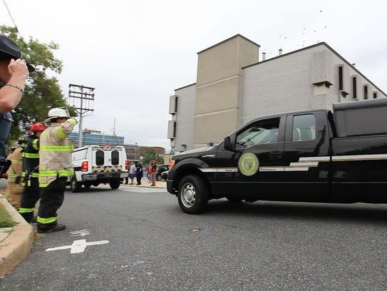 A motorcade arrives at the Delaware medical examiner's