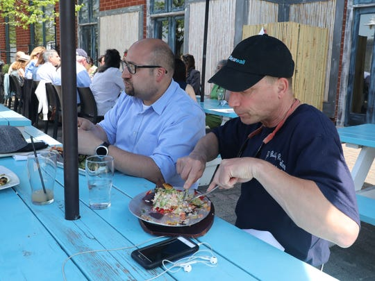 Jamie Martinez, left, the director of the Yonkers downtown BID and Robert Hothan, one of the founders, enjoy their meal with the Yonkers lunch group at Dolphin restaurant on the Yonkers waterfront, May 3, 2018.