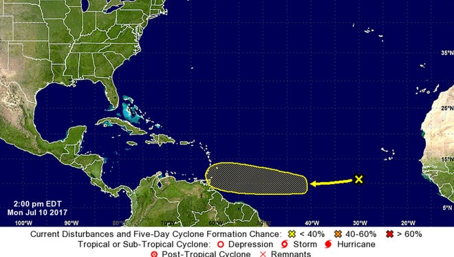A graphic issued by the National Hurricane Center at 2 p.m. Monday shows the position and current forecast track of a cluster of thunderstorms associated with a tropical wave off the coast of Africa.