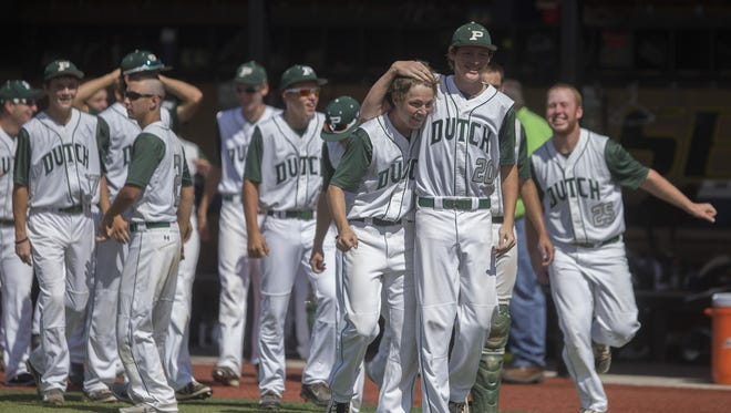 Pella's Caleb Piersma and Lucas Hillman embrace after defeating Dallas Center-Grimes in the Class 3-A state baseball quarterfinal at Southeast Polk in Pleasant Hill, Wednesday, July 29, 2015.