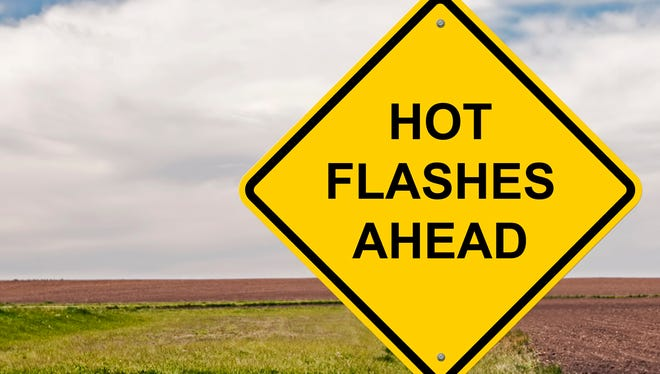Women can cope with hot flashes by dressing in layers, consuming cold drinks, avoiding spicy foods or trying hormone replacement therapy.