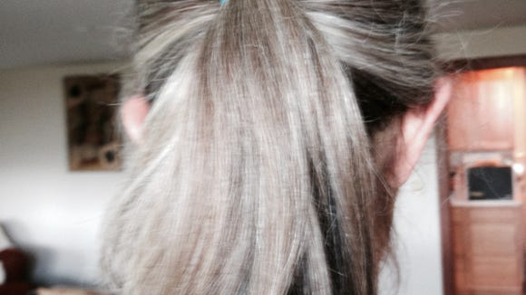 For cooks with long hair, this is a must-do hair do. You gotta admit, it's prettier than a hair net.