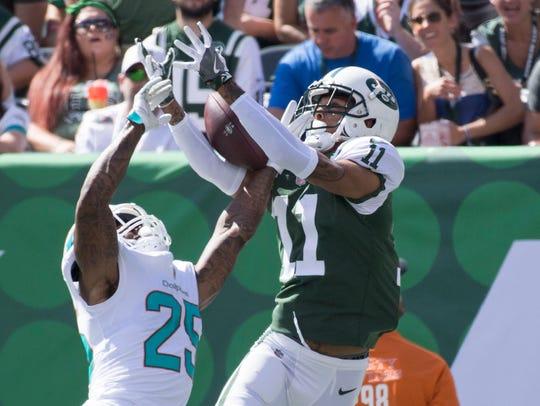 Miami Dolphins cornerback Xavien Howard breaks up a