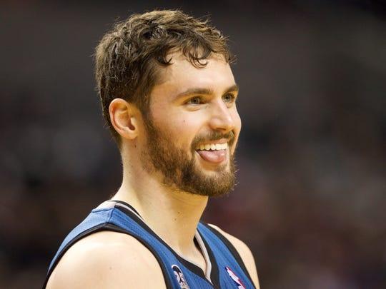 Minnesota Timberwolves power forward Kevin Love (42) smiles on the court against the Portland Trail Blazers, Feb. 23, 2014.