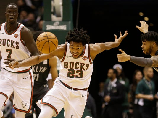 Milwaukee Bucks' Sterling Brown (23) chases down a loose ball during the first half of the team's NBA basketball game against the Brooklyn Nets on Friday, Jan. 26, 2018, in Milwaukee. (AP Photo/Jeffrey Phelps)