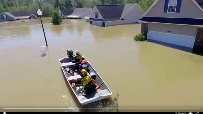 Footage shows the rescue of a man from floodwaters in North Carolina.