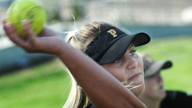 SeaEnna Satcher tosses the ball during Newbury Park's practice Friday.