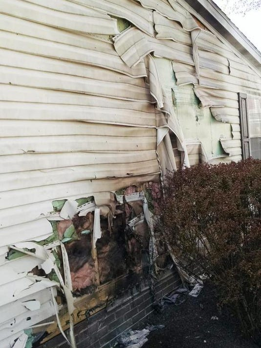 Damage is shown from an attempted arson fire to a property in the 100 block of Centennial Avenue in Hanover Borough on Tuesday evening.