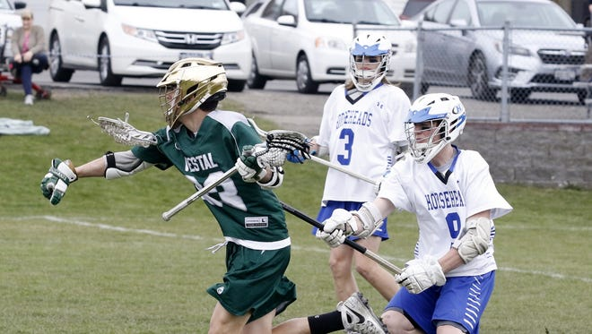 Matt Thrasher of Vestal controls the ball as Evan Coleman (9) and Dawson Felenchak (3) of Horseheads defend April 24, 2018 during Vestal's 9-8 victory at Horseheads.