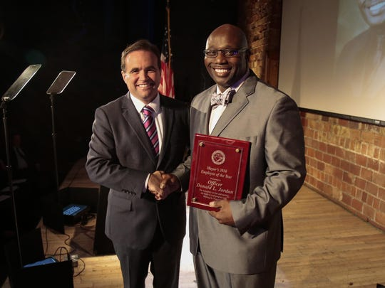 City of Cincinnati Mayor John Cranley, left, awards Cincinnati Police Officer Donald L. Jordan the Employee of the Year award during the 2016 State of the City speech, Tuesday, Oct. 4, 2016, at the 20th Century Theater in Oakley.