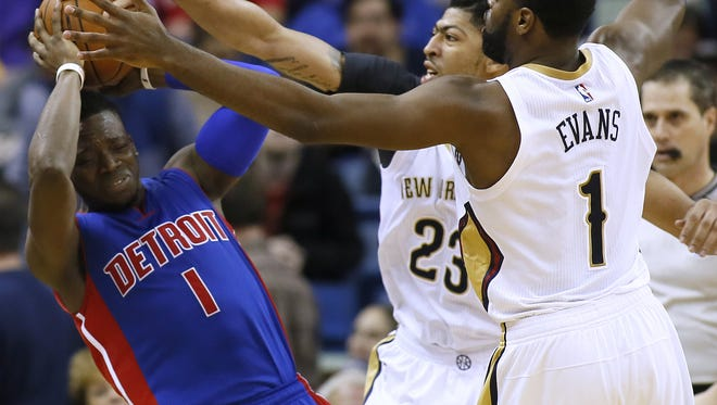 Pelicans guard Tyreke Evans and forward Anthony Davis try to steal the ball from Reggie Jackson during the first half.