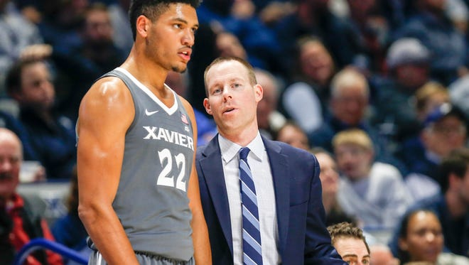 Photo by: Frank Victores. Pictured: Then Xavier assistant coach Travis Steele talks in-game with junior Kaiser Gates.