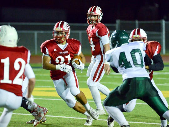 St. Philip's Brayden Darr runs against Portland St. Patrick on Friday.