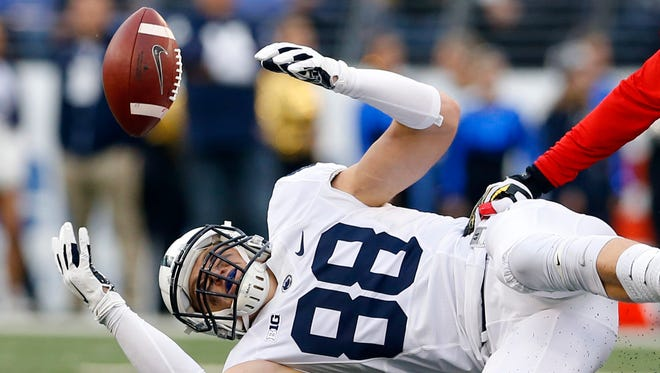 Penn State tight end Mike Gesicki, left, struggled to catch passes this season amid big expectations. He said he is turning the experience into a positive.