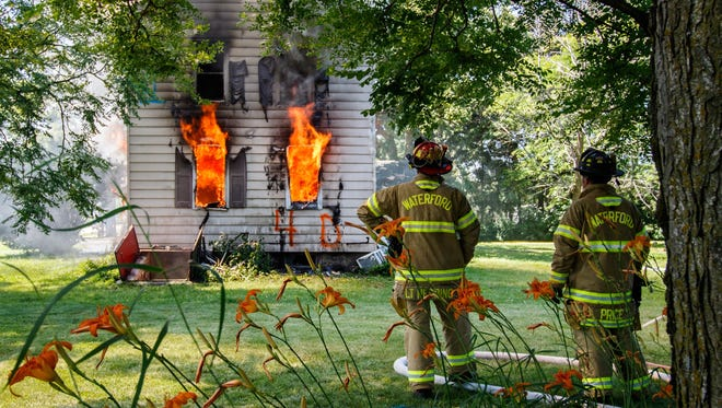 Members of the Waterford Fire Department participate in a live fire training hosted by the Mukwonago Fire Department on Saturday, July 8.